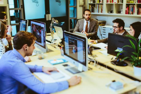 Workspace Furniture, Revolver Revolver team working on a Lean Desk