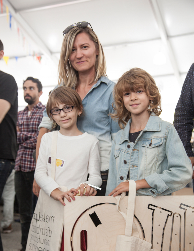 Photo of a mom and kids just bought a edie stool at the New York Maker Faire