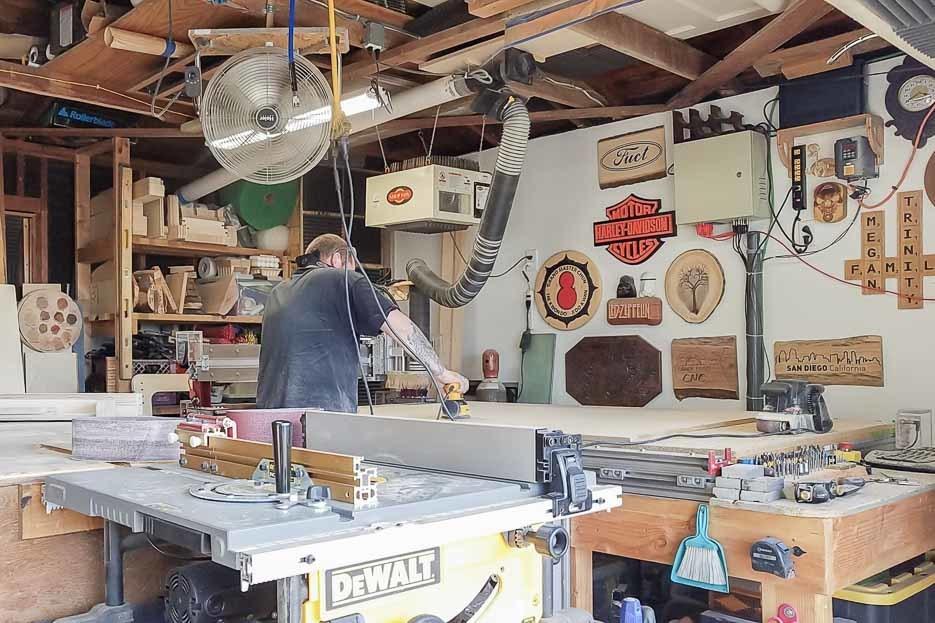 Kyle in his workshop making a Studio Desk