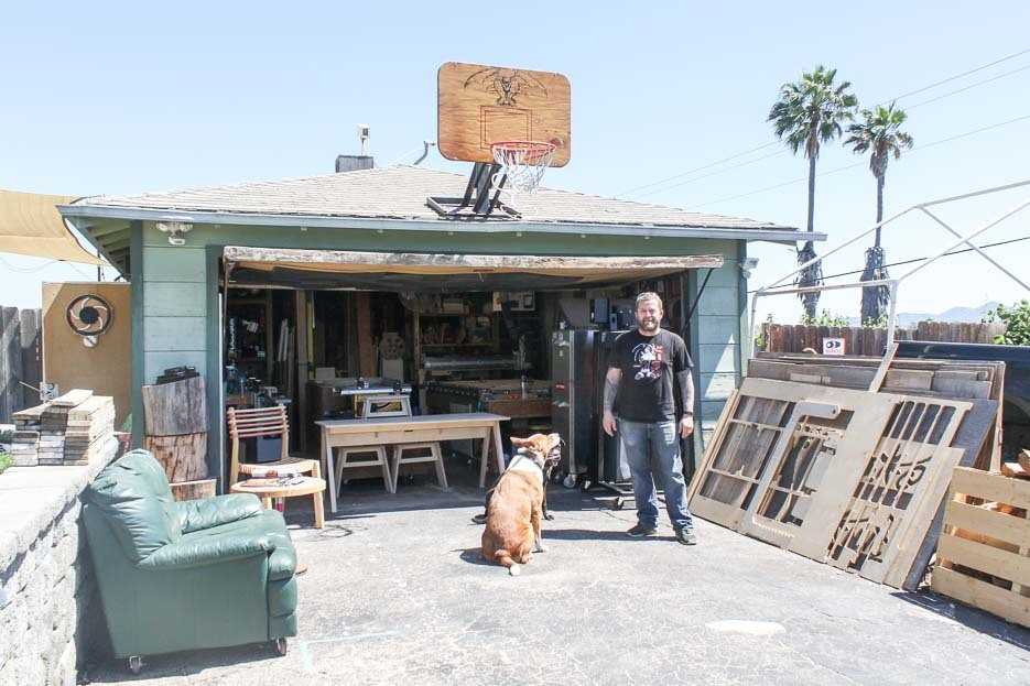 Kyle and his dogs outside his workshop in the Californian sun