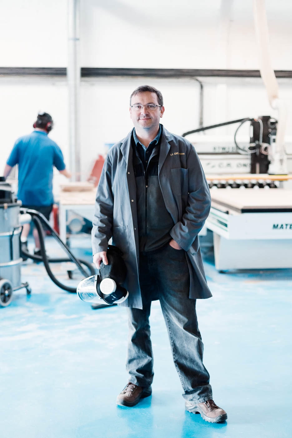 Ian Jinks from I.J CNC Services standing in his workshop