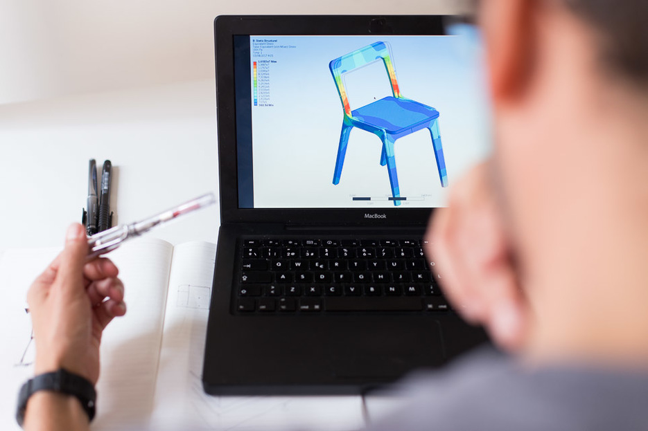 Jose Pacheco testing his Slim Chair in computer simulations