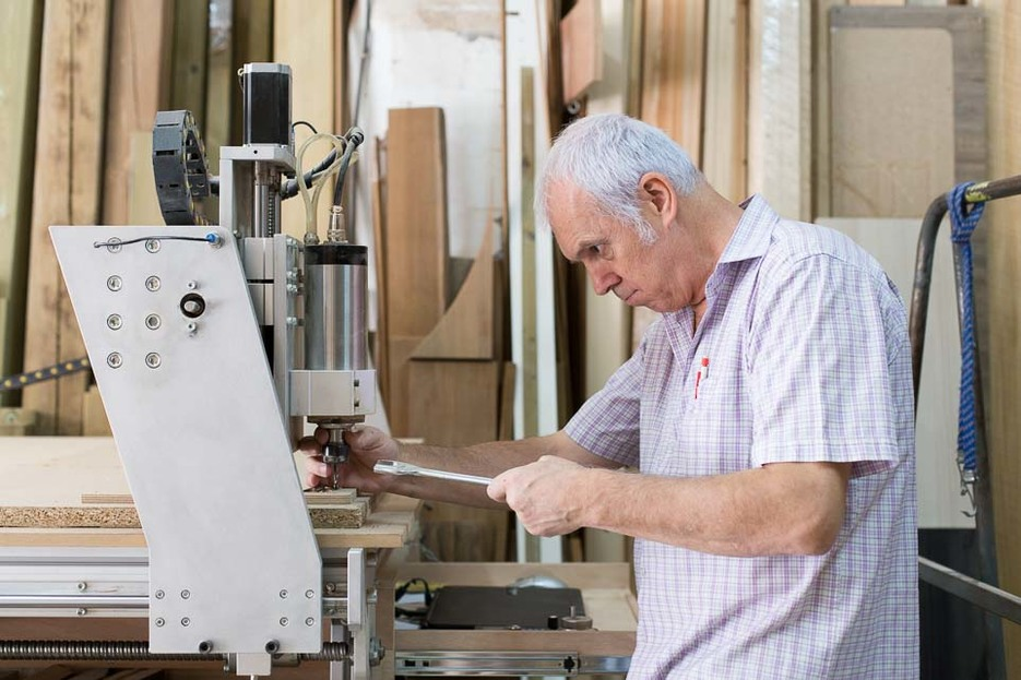 Sergi operating his CNC machine